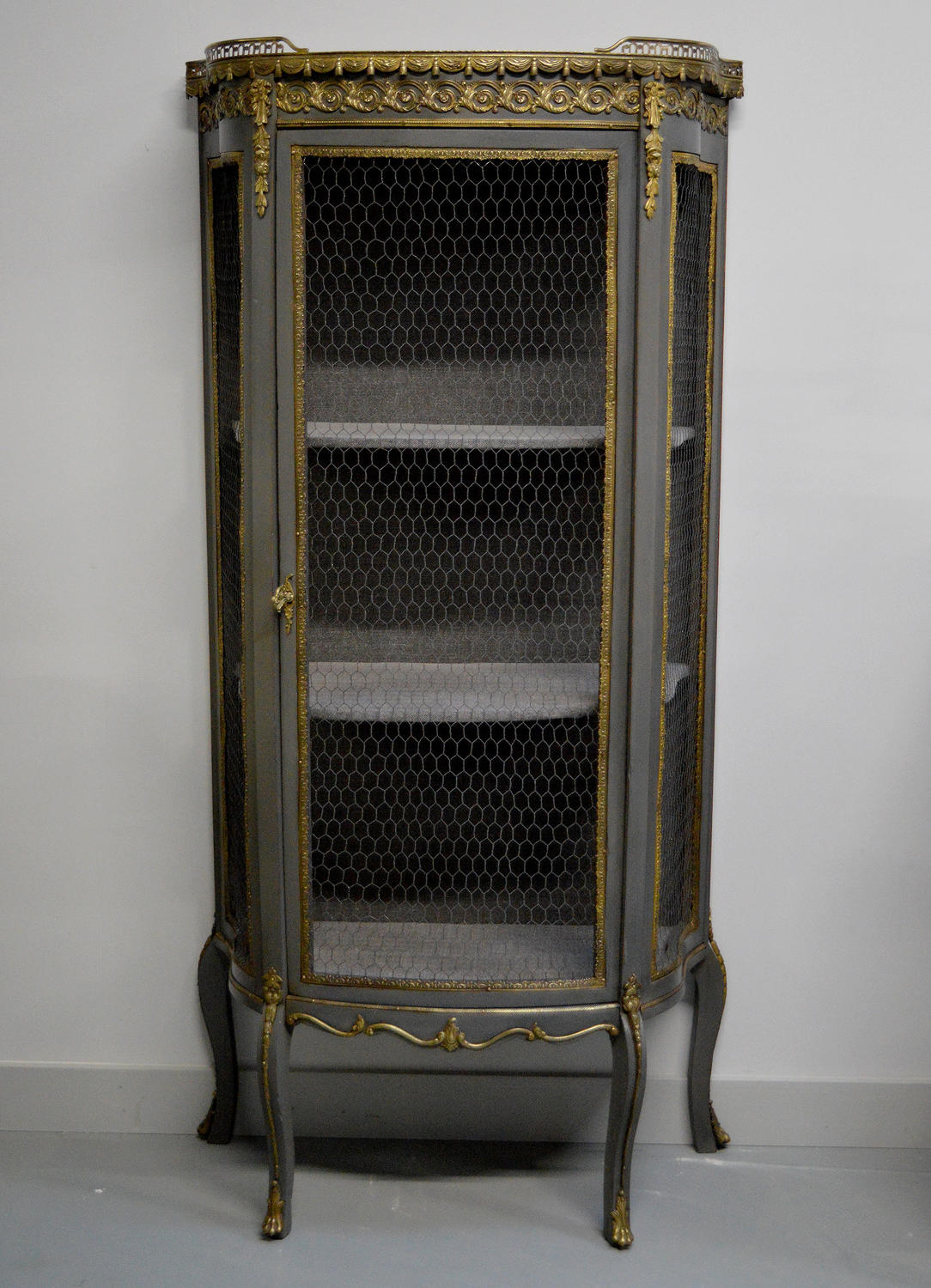 19th Century Louis XVI style wire bow front display cabinet