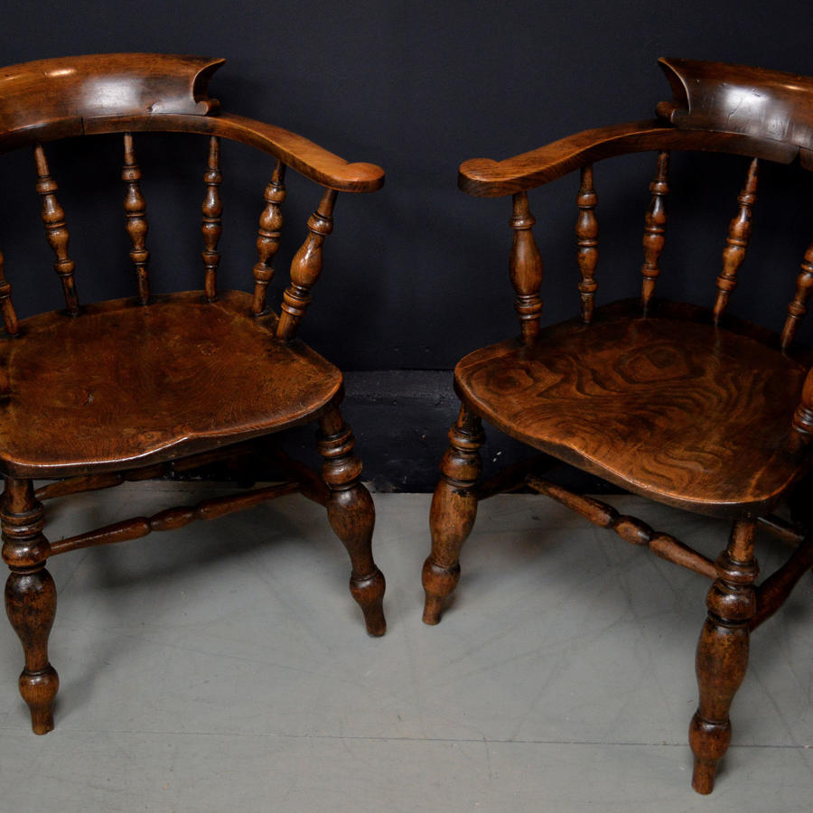 Pair of 19th Century 'Smokers Bow' armchairs