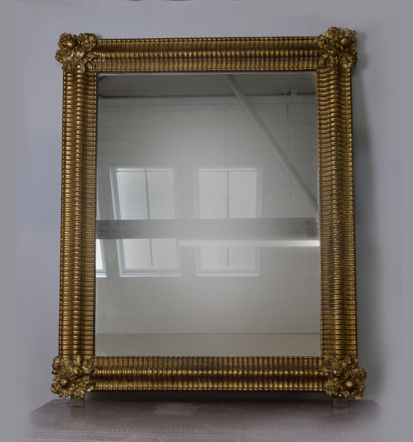 Mid 19th century Louis Philippe ripple frame gilt mirror